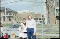 An Augsburg women's tennis team player takes a picture with a coach, 1989.