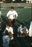 Augsburg women's soccer team players circle up to talk, 1989.