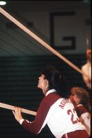 Augsburg women's volleyball team players play defense, 1989.