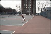 An Augsburg women's tennis team player plays in a singles match, 1989.