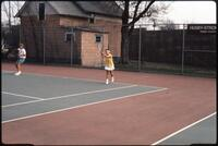 Augsburg women's tennis team players plays in a doubles match ,1989.