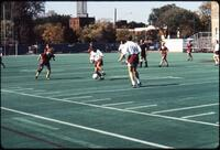 An Augsburg women's soccer team player dribbles in the midfield, 1989.