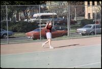 An Augsburg women's tennis team player swings her racket, 1988.