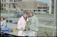 An Augsburg women's tennis team player takes a photo with her coach, 1989.