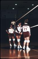 Augsburg women's volleyball team players play in a match, 1989.