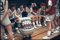 Augsburg women's basketball team players talk to their coach during a timeout, 1989.