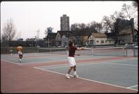 An Augsburg women's tennis team player plays in a match against a rival, 1989.