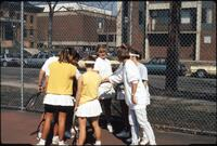 Augsburg women's tennis team players huddle up before their matches, 1989.