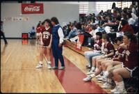 An Augsburg women's basketball team coach talks to a team player, 1989.