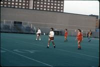 Augsburg women's soccer team players track back from the midfield, 1989.