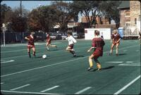 An Augsburg women's soccer team defender clears the ball, 1989.