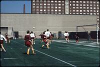 Augsburg women's soccer team players defend a cross, 1989.