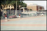 Augsburg women's tennis team players play doubles during practice, 1988.