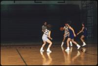 An Augsburg women's basketball team players passes the ball to her teammate, 1990.