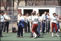 An Augsburg women's softball team player with her parent on senior day, 1990.