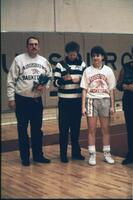 An Augsburg women's basketball team player with her parents on her senior day, 1989.