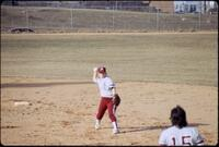 An Augsburg women's softball team player throws the ball to a teammate, 1991.