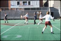 An Augsburg women's soccer team player passes the ball in the midfield, 1990.