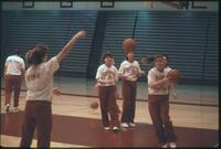 Augsburg women's basketball team players warm up before a game, 1989.