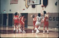 An Augsburg women's basketball team player goes up for a layup, 1990.