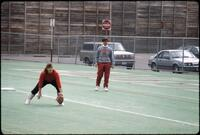Augsburg women's softball team player warm up before a game, 1991.