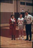 An Augsburg women's basketball team player with her parents on senior night, 1989.