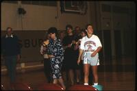 An Augsburg women's basketball team player with her parent on senior day, 1990.