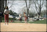 Augsburg women's softball team players during a game, 1991.
