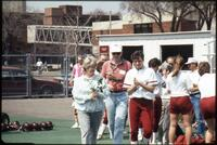 An Augsburg women's softball team player with her parents on senior day, 1990.