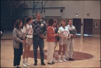 Augsburg women's basketball team player with their parents, 1989.