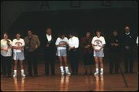 Augsburg women's basketball team players with their parents on senior day, 1990.