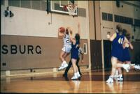 An Augsburg women's basketball team player attempts a layup in a game, 1989.