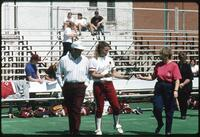 Augsburg women's softball player handing rose to a woman, 1991