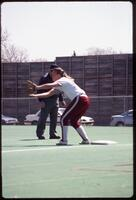 Augsburg women's softball player with arm outstretched to catch ball, 1991
