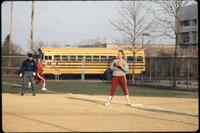 Augsburg women's softball player stands on base, April 1992