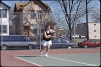 Augsburg women's tennis player runs to hit ball with racket, 1991