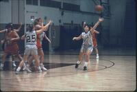 Augsburg women's basketball player throws ball, February 1992