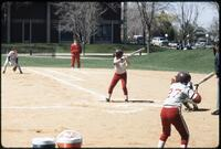 Augsburg women's softball player at bat, 1991