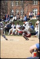 Augsburg women's softball catcher with mitt extended, 1991
