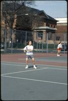 Augsburg women's tennis player prepares to hit incoming ball, May 1992