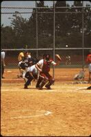 Augsburg women's softball catcher prepares to catch incoming ball, May 1992