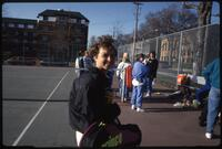 Augsburg women's tennis player carrying tennis racket bag, 1992