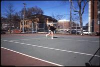 Augsburg women's tennis player runs to hit ball, April 1993