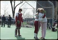 Augsburg women's softball coach gives hug to player, 1991