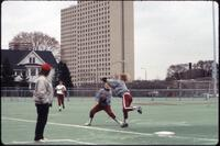 Augsburg women's softball player jumps to catch ball, April 1992