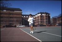 Augsburg women's tennis player walking on court with ball in hand, April 1993