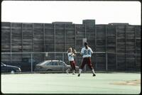 Two Augsburg women's softball players playing catch, 1991
