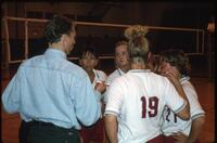 Augsburg women's volleyball players and coach talk with unidentified man, November 1992