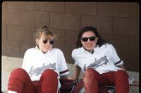Two Augsburg women's softball players relaxing while wearing sunglasses, 1991