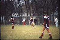 Augsburg women's soccer players walk on the field, 1991